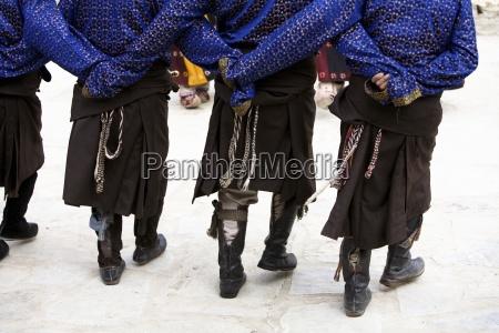 low section of men dancing leh