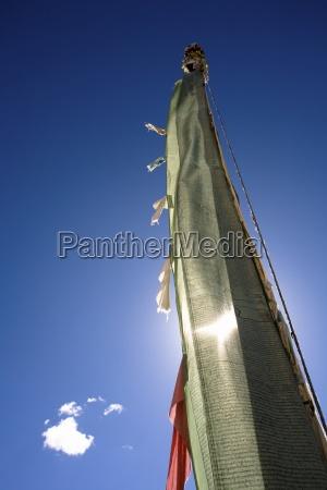 prayer flag against a clear blue