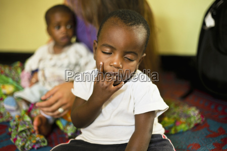 ugandan child with his fingers in