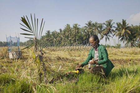 woman making a offering in a