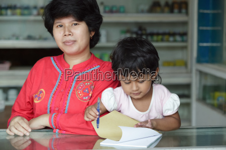 pharmacy owner with her child in