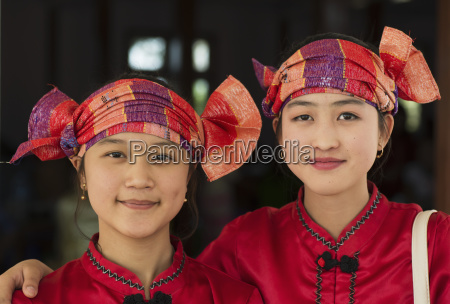 two women wearing the national costume