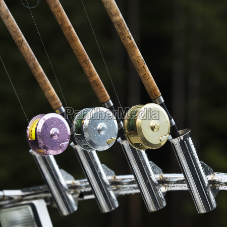three fishing rods with different coloured