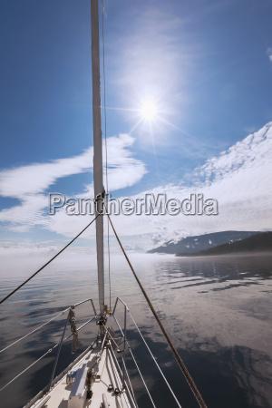 a sailboat journeys on johnstone strait