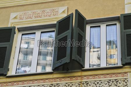 shutters open on a buildings windows
