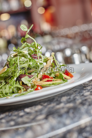 plated salad with pancetta cherry tomato