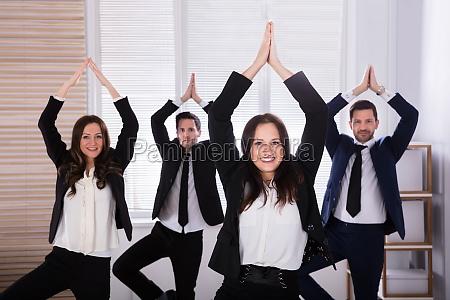 businesspeople doing yoga