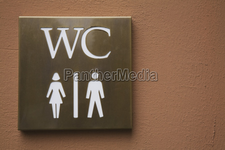 woman and man pictogram washroom sign