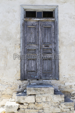 weathered wooden door with stone slab