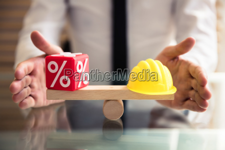 hand protecting balance between percentage and