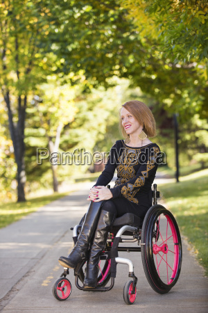 young paraplegic woman in her wheelchair