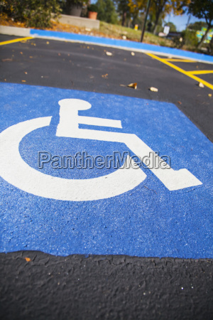 handicap symbol painted in a parking