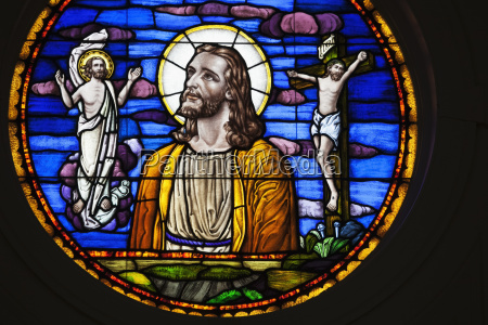 stained glass window depicting jesus christ