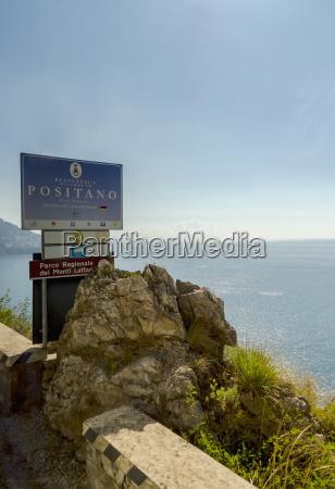 the amalfi coast drive highway sign