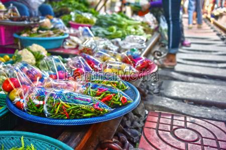 selling food on the maeklong railway