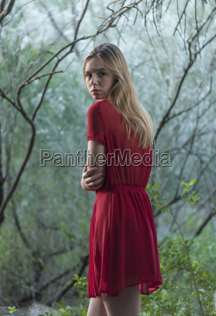 a girl wearing a red dress