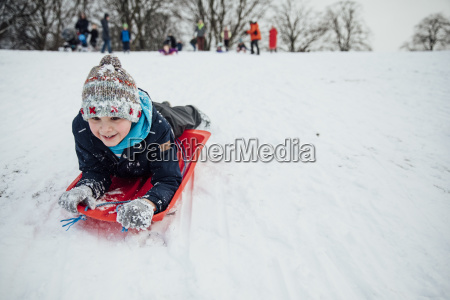 sledding like a penguin