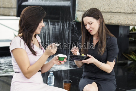 two business women having lunch together