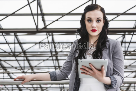 attractive young millennial business woman with
