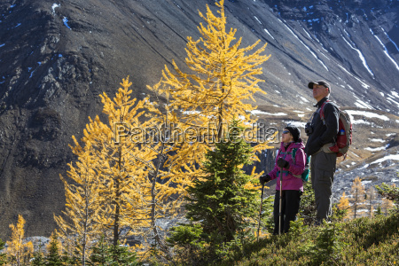 female and male hiker standing next