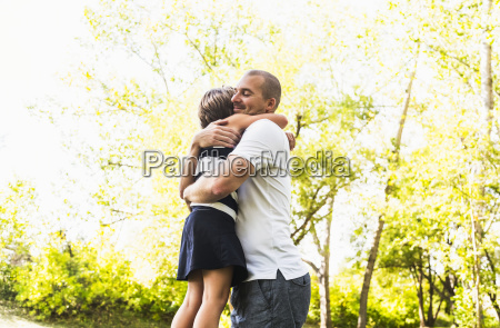 father hugging his daughter in a