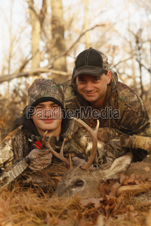 portrait of father and son hunters