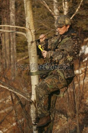 bowhunter calling deer