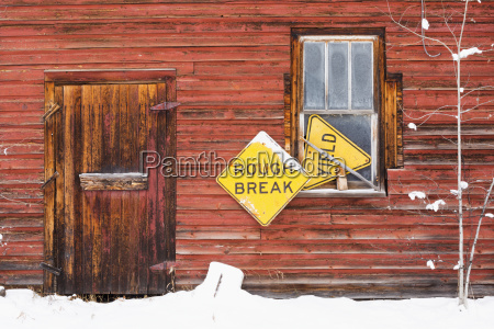 a red wooden building with two