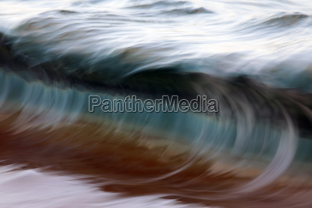 ocean wave blurred by motion hawaii