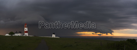souter lighthouse under ominous storm clouds