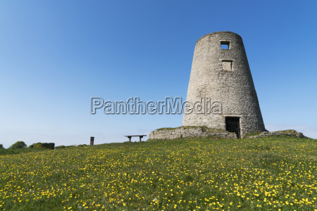 round tower with a field of