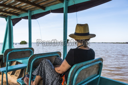 a woman sits on a boat