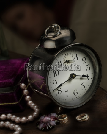 a vintage clock on a bedside