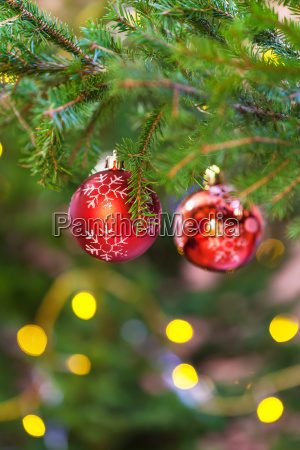 two red balls on natural fir