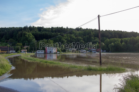 flooded road field and houses in