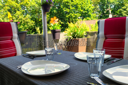 covered balcony table with white plates