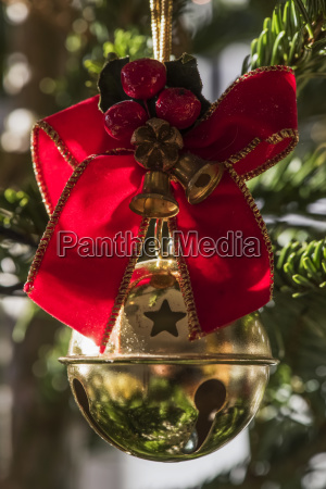 golden bauble with ribbon on christmas