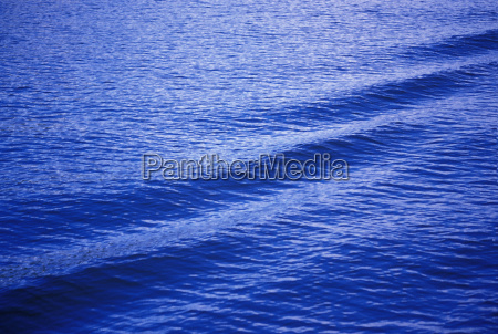 ripples and waves on dark blue