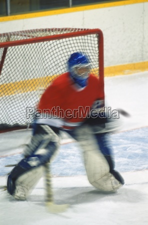 hockey goalie making save