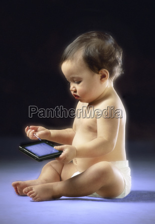baby playing with pda
