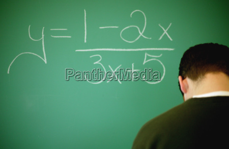 student at the chalk board
