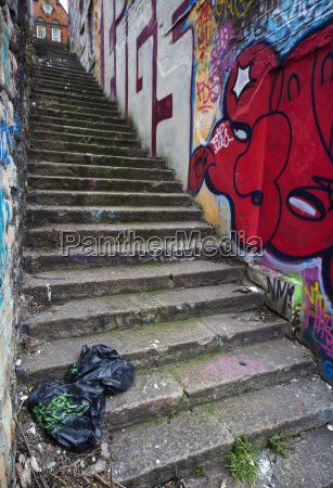 steep concrete steps with a graffiti