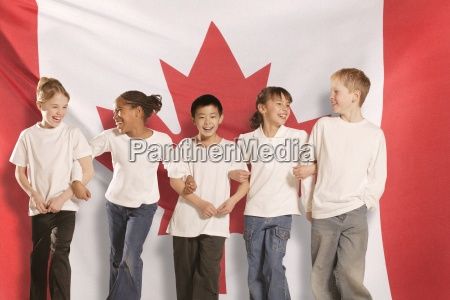 children in front of canadian flag