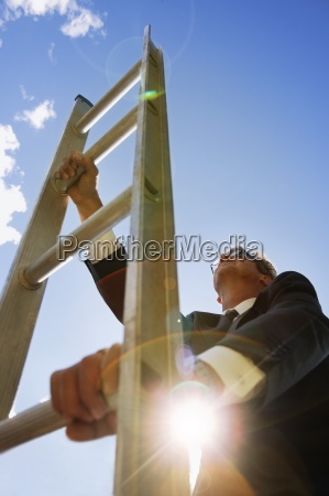 businessman climbs the corporate ladder