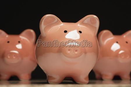 three pottery pigs