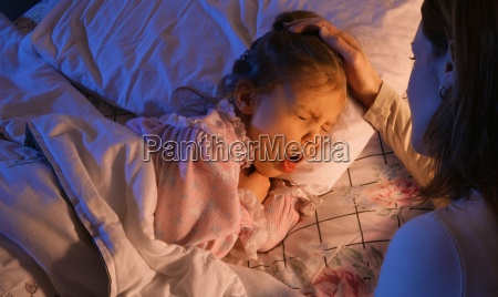 mother beside sick child