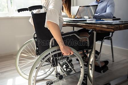 disabled businesswoman sitting on wheelchair