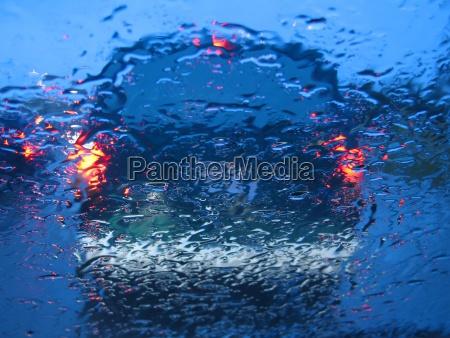 waiting in traffic while raining