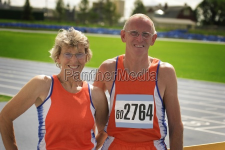 two senior athletes at the track