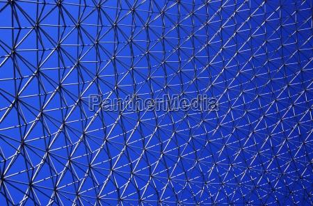 metal mesh against a blue sky